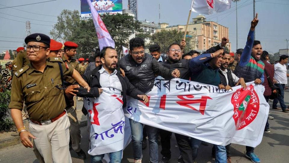 All Assam Students' Union (AASU) activists are detained by police while trying to block NH 37 near Basistha during a protest against the recent attack on AASU members at Ghagrapar by alleged BJP activists, in Guwahati. (PTI)
