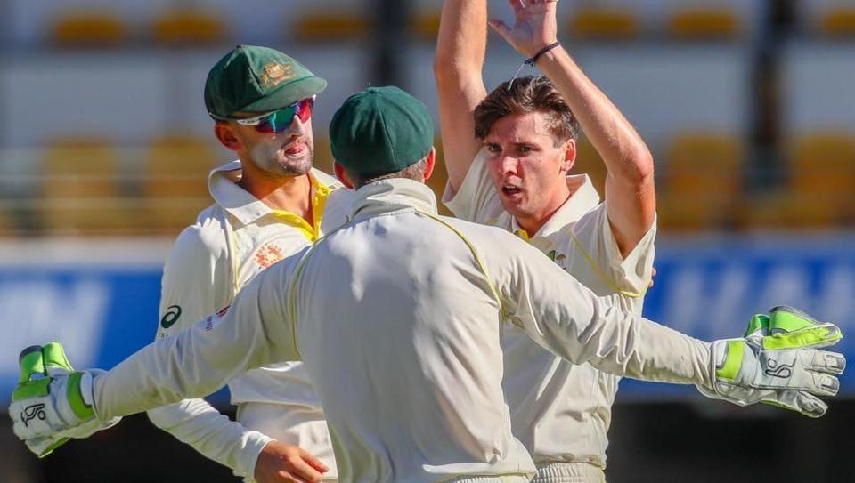 Australia's Jhye Richardson (R) celebrates the wicket of Sri Lanka's Niroshan Dickwella during the day-night Test cricket match between Australia and Sri Lanka at the Gabba Cricket Ground in Brisbane on January 26, 2019