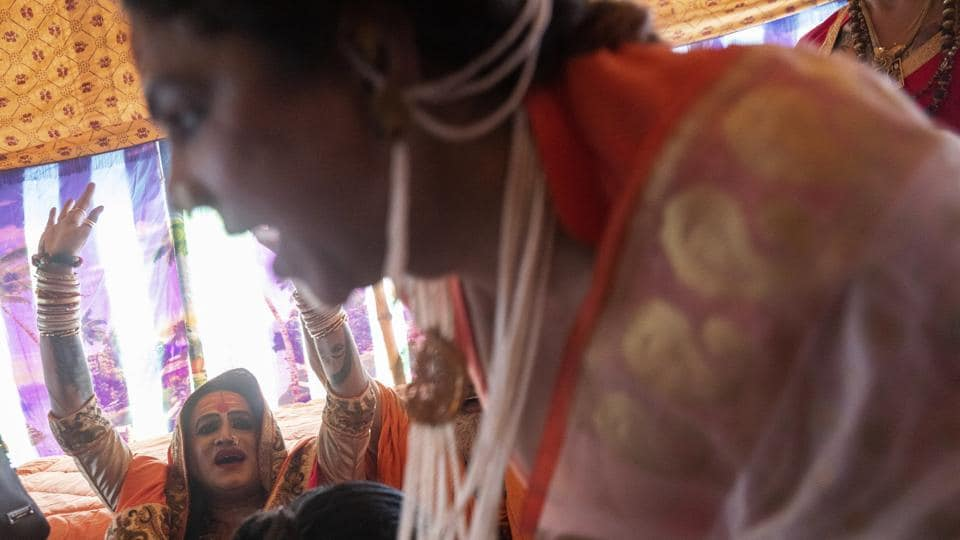 """Laxmi Narayan Tripathi, a transgender activist and leader of the """"Kinnar akhara"""" monastic order, celebrates the invitation by the """"Juna Akhad"""" during the Kumbh Mela in Prayagraj. One of the most orthodox orders, the Juna akhara, invited Kinnar to take part in the Kumbh's first royal bath on January 15. Since then, Tripathi has been pushing for recognition by the umbrella group that sets rules for the akharas. (Bernat Armangue / AP)"""