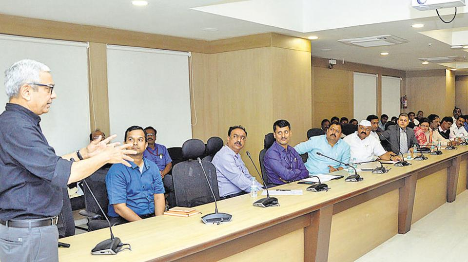 Ahmedabad-based architect Bimal Patel (left) addressing officials of Pune municipal corporation about the benefits of town planning schemes, in the city, on Wednesday.