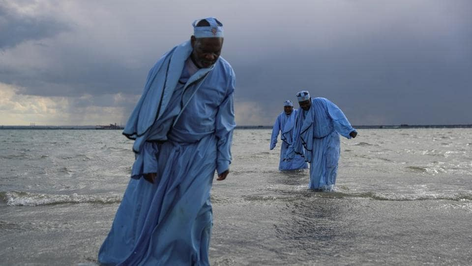 Senior members of the Apostles of Muchinjikwa Christian church leave the sea after leading a mass Baptism (Jorodhani) on the beachfront on Southend-on-Sea, Britain. Around 250 black majority churches are believed to operate in the borough of Southwark, where 16% of the population identifies as having African ethnicity. (Simon Dawson / REUTERS)