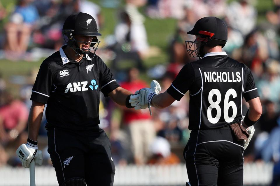 New Zealand's Ross Taylor (L) and Henry Nicholls gesture during the fourth one-day international cricket match between New Zealand and India at Seddon Park in Hamilton. (AFP)