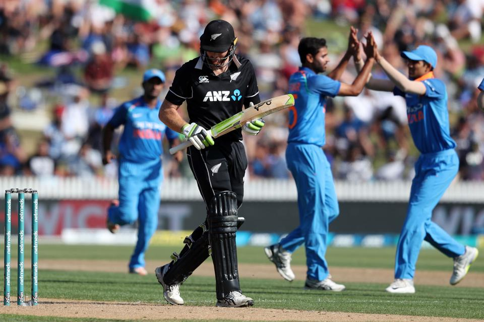New Zealand's Martin Guptill (C) reacts after being dimissed during the fourth one-day international cricket match between New Zealand and India at Seddon Park in Hamilton. (AFP)