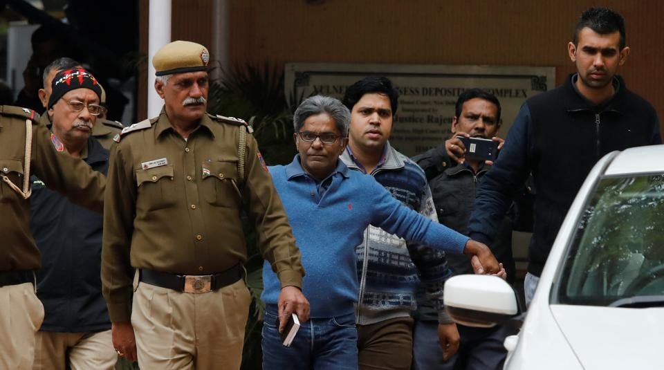 Rajiv Saxena (C), an accused in India's abortive, scandal-tainted helicopter deal with Anglo-Italian firm Agusta Westland, is escorted by police as he leaves a court in New Delhi, India, January 31, 2019.