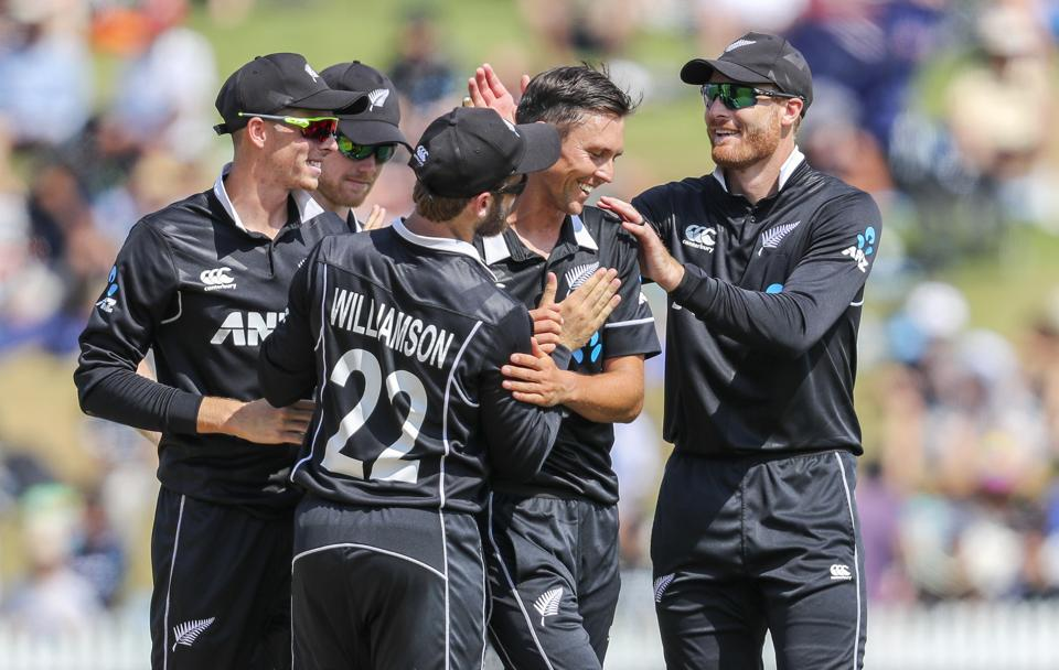 New Zealand's Trent Boult, second from right, is congratulated on taking an Indian wicket during their one day international cricket match at Seddon Park in Hamilton. (AP)