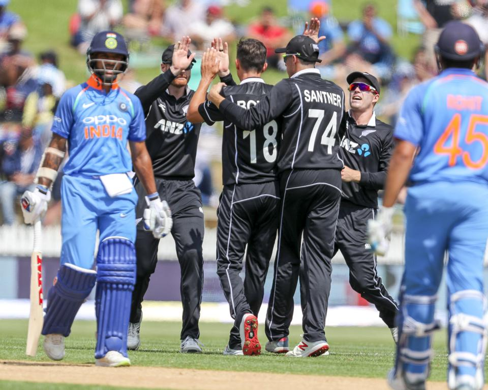 New Zealand celebrates the wicket of India's Shikhar Dhawan, left, during their fourth one day international cricket match at Seddon Park in Hamilton. (AP)
