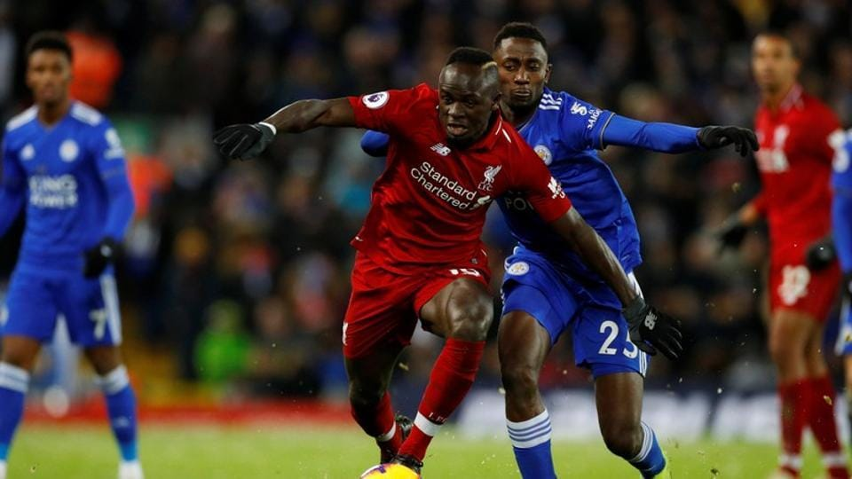 Liverpool's Sadio Mane in action with Leicester City's Wilfred Ndidi