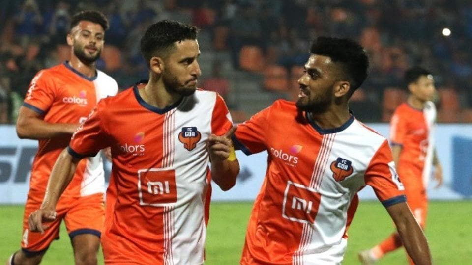 Players of FC Goa celebrate after scoring a goal.