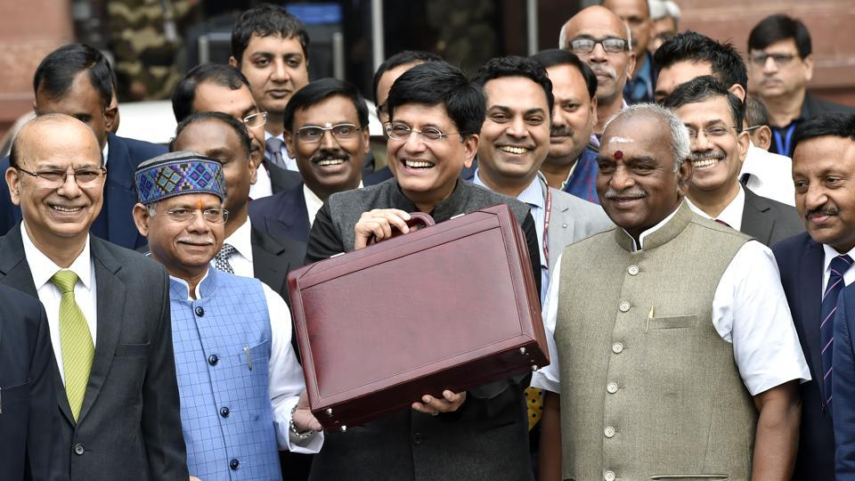 Finance minister Piyush Goyal (C) along with his full Budget team leaves for Rashtrapati Bhawan, at North Block, in New Delhi, India, on Friday, February 1, 2019.