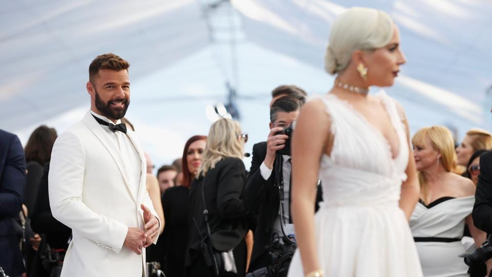 Singer Ricky Martin looks on at singer Lady Gaga at the 25th Screen Actors Guild Awards in Los Angeles, California. (Mario Anzuoni / REUTERS)