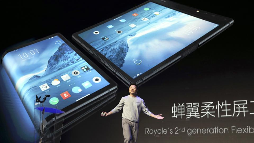 In this Wednesday, Oct. 31, 2018, photo, Royole Corporation founder and CEO Bill Liu unveils what is described as the world's first commercial foldable smartphone called the Royole FlexPai during an event in Beijing. China is an important market for smartphone manufacturers due to its size and increasingly wealth population.
