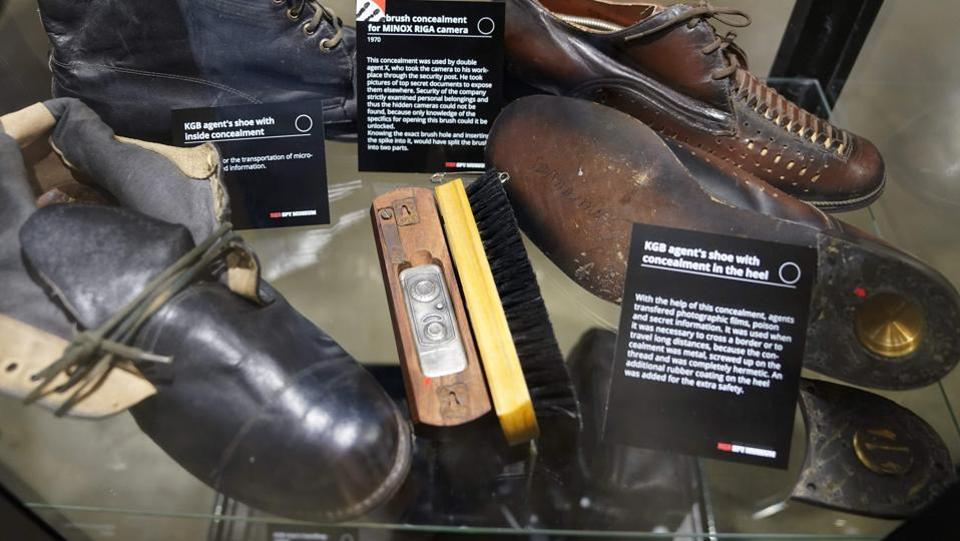 Specially purposed shoes on display at The KGB Spy Museum. As an optional extra, visitors can take a tour with a Russian-speaking guide -- such as Sergei Kolosov, a former detective with the Saint Petersburg police who remembers using some of the items on show. Urbaitis and his daughter Agne Urbaityte, 29, describe themselves as co-curators of the show, whose owner is an American company which wishes to remain anonymous. (Timothy A. Clary / AFP)