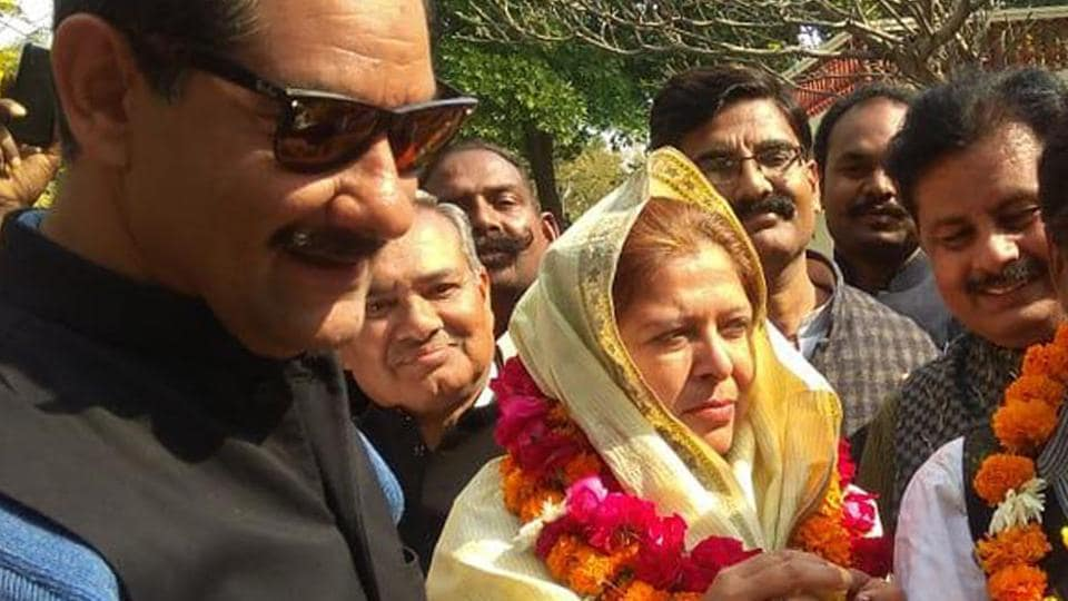 (FROM LEFT) Jitendra Singh,  Congress candidate Shafia Khan and her husband Zubair Khan celebrate Shafia's victory in Ramgarh polls, on  Thursday, January 31, 2019.