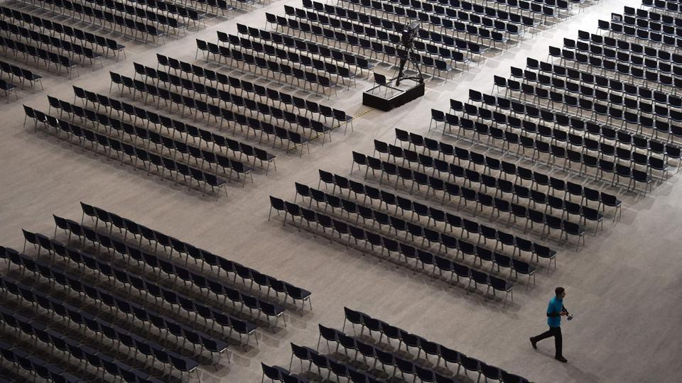 An employee walks between seats ahead of the Siemens company's annual shareholder's meeting in the Olympic hall in Munich, southern Germany. (Christof Stache / AFP)