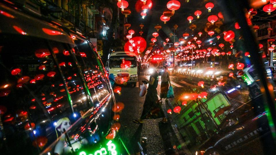 People walk under decorative lanterns ahead of the Chinese New Year in Yangon's Chinatown district. (Ye Aung Thu / AFP)
