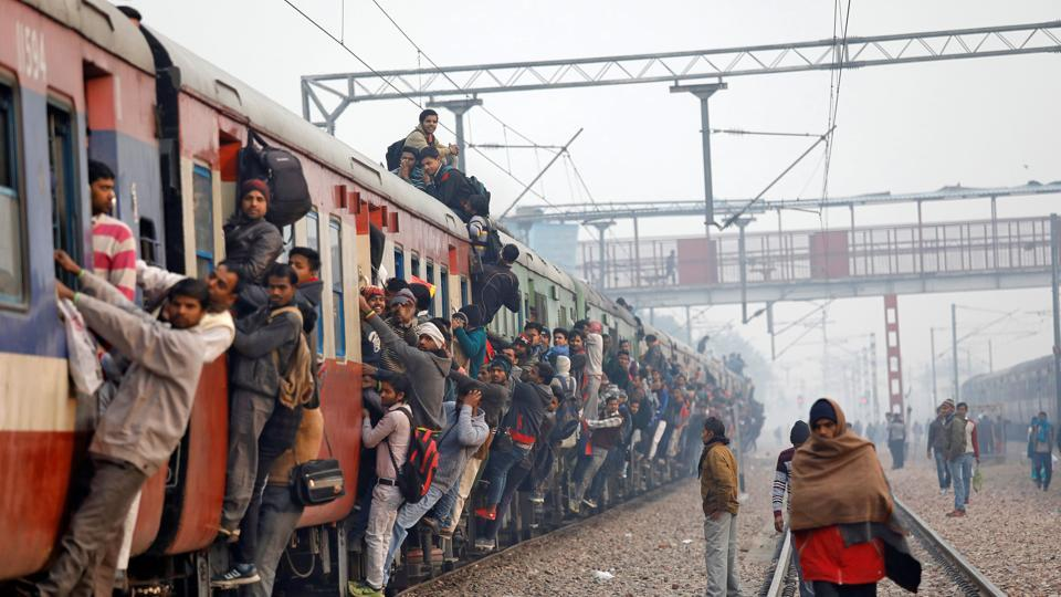 Commuters travel in an overcrowded train near a railway station in Ghaziabad, on the outskirts of New Delhi, India, February 1, 2019.