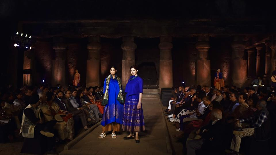 "Models showcase dresses made from traditional Indian fabrics based on GI (Geographical Indication) textiles drawn from various regions across India during an event ""Artisan Speak"", at the UNESCO World Heritage site of Elephanta Caves near Mumbai, Maharashtra. (Anshuman Poyrekar / HT Photo)"