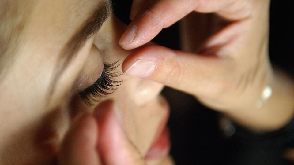 In this file photo taken on September 11, 2005, A model gets false eyelashes applied backstage at the Diesel Spring 2006 fashion show during Olympus Fashion Week at Hammerstein Ballroom in New York City.