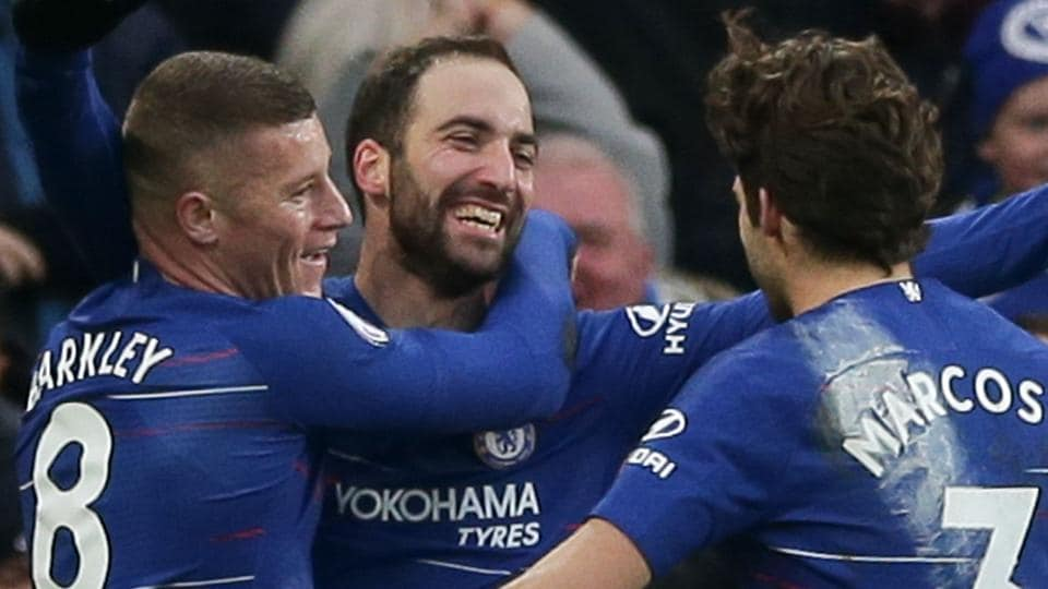 Chelsea's Argentinian striker Gonzalo Higuain (C) celebrates scoring their fourth goal during the English Premier League football match between Chelsea and Huddersfield.