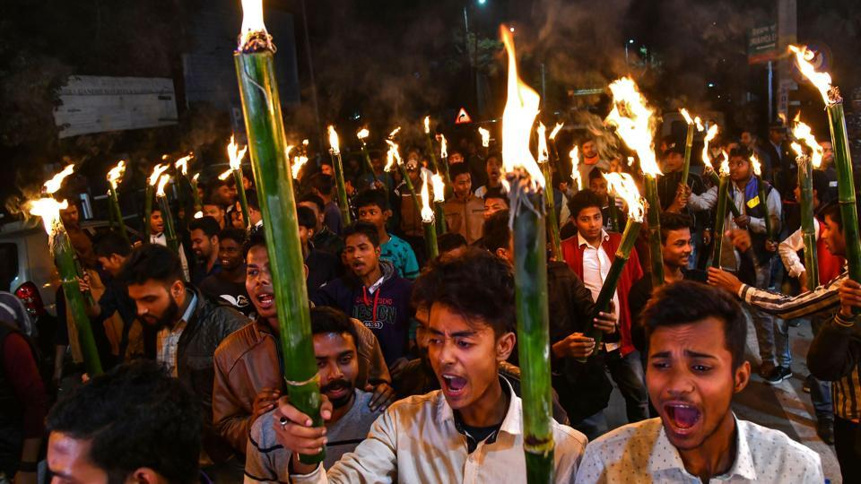 Activists of All Assam Students Union (AASU) along with 30 indigenous organizations take out a torch light procession to protest against the Citizenship Amendment bill in Guwahati.