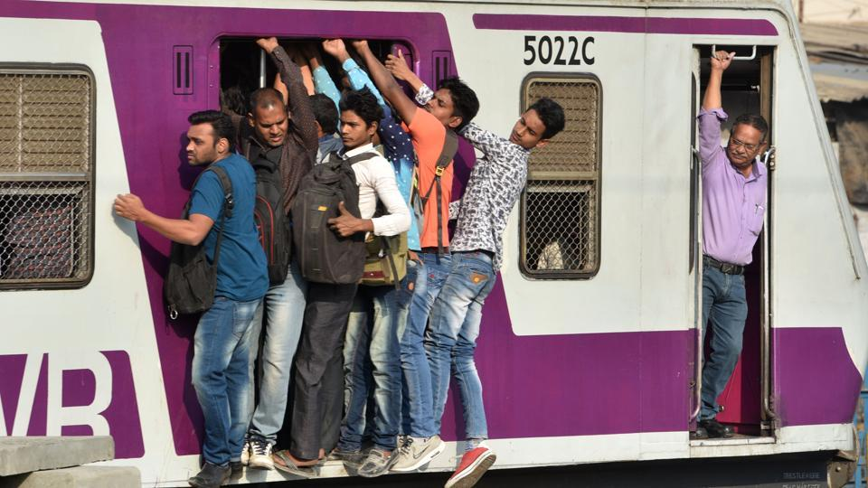 Commuters seen travelling from Borivali to Churchugate in a the crowed local train at Goregaon in Mumbai, Maharashtra. (Satyabrata Tripathy / HT Photo)