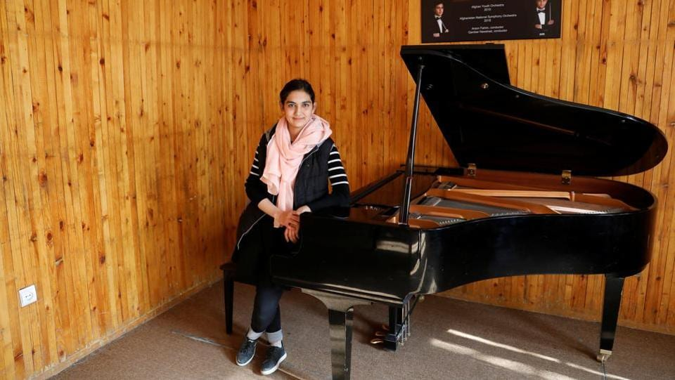 "Maram Atayee, 16, is a pianist at the Afghan National Institute of Music. ""The thing I'm most worried about is that if they return, I'll not be able to continue playing music,"" Atayee said. ""It will be great if the government and the Taliban reach a peace deal. At that time there should be access to music for everyone and women's rights must be protected."" (Mohammad Ismail / REUTERS)"