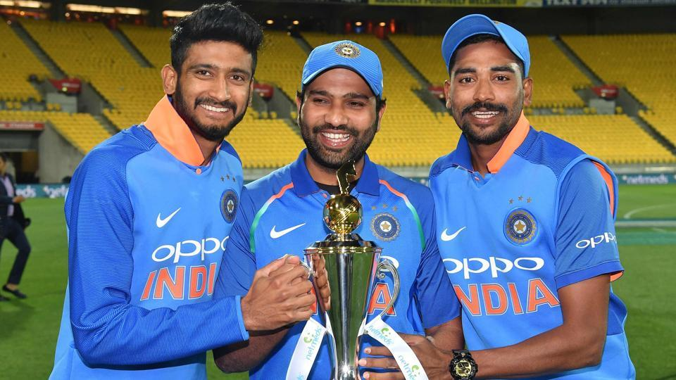 India's Khaleel Ahmed (L) with teammates Rohit Sharma (C) and Mohammed Siraj (R) pose with the trophy. (AFP)