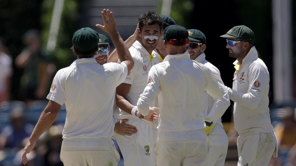 Australia's Mitchell Starc (centre) is congratulated by teammates after taking 5 wickets against Sri Lanka.