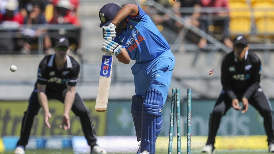 India's Rohit Sharma, center, is bowled by New Zealand's Henry Nicholls. (AP)