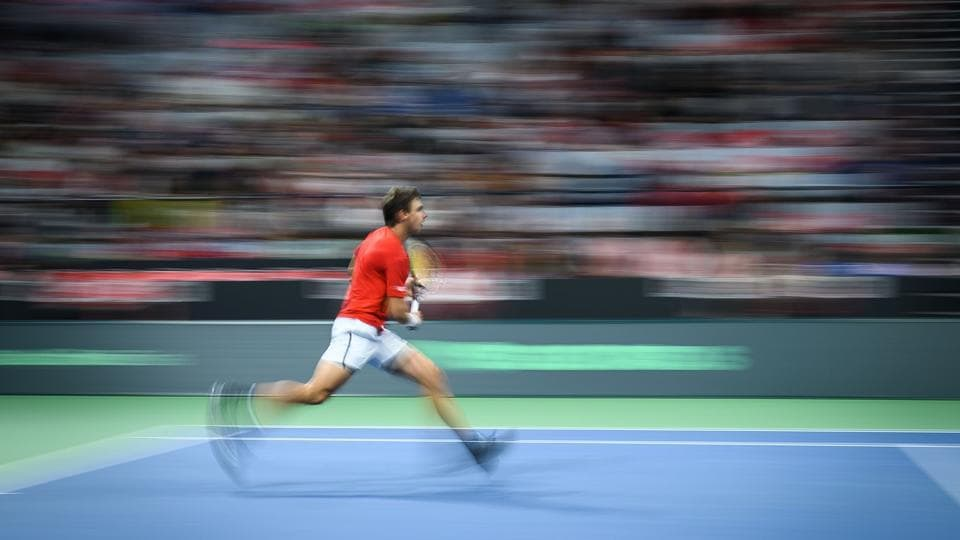 Switzerland's Henri Laaksonen runs during his match at the Davis Cup tennis qualifier between Switzerland and Russia in Biel, Switzerland.