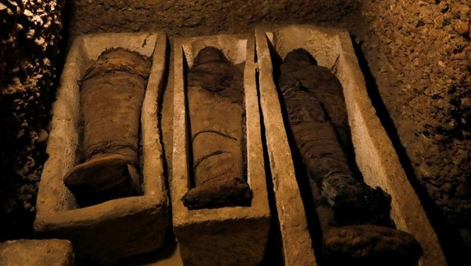 Egypt has unveiled over 40 mummies dating back to the Ptolemaic era at a communal burial site in Minya, 260 kilometres south of Cairo. The remains were found laid on the floor or in open clay coffins in the crumbling chamber. (Amr Abdallah Dalsh / REUTERS)