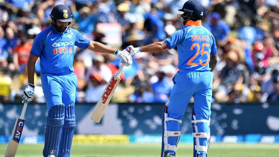 India's Shikhar Dhawan (R) celebrates hitting a four with teammate Rohit Sharma (L) during the second one-day international (ODI) cricket match between New Zealand and India in Tauranga on January 26, 2019