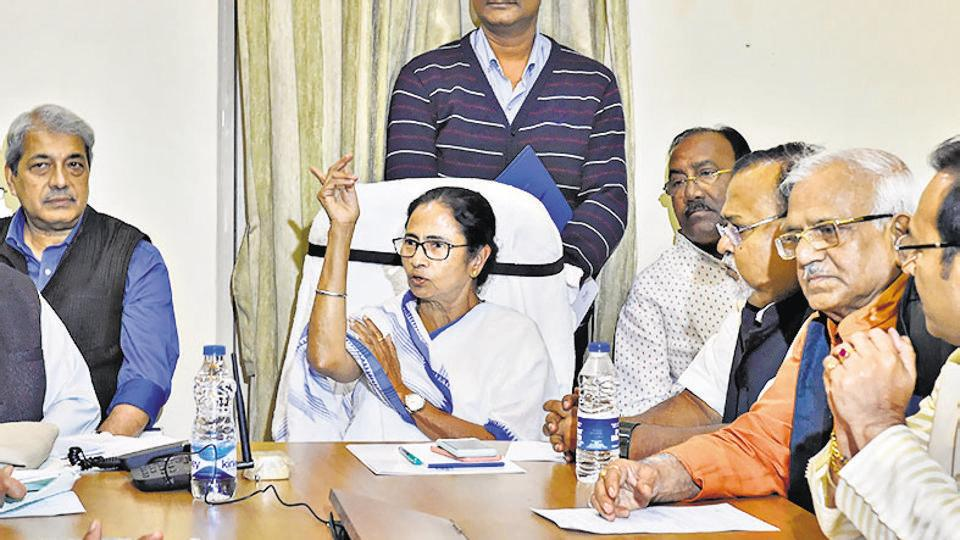 West Bengal Chief Minister Mamata Banerjee chairs a cabinet meeting  in a traffic police outpost   near the site of her dharna in Kolkata  to protest the CBI's attempt to question the Kolkata Police commissioner in connection with chit fund scams,
