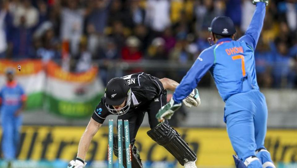India's MS Dhoni, right, runs out New Zealand's James Neesham during their fifth one day international at Westpac Stadium in Wellington, New Zealand, Sunday, Feb. 3, 2019