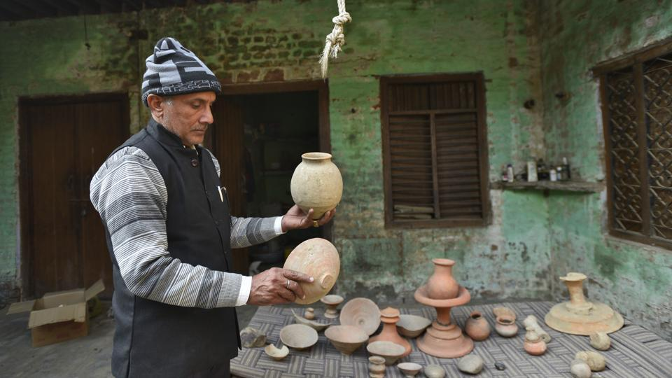 "52-year-old school teacher Ramesh Chandra became interested in collecting the remains after finding a pot in his fields. Over the years, his collection has grown to include urns, broken pots, seals and bits and pieces of terracotta jewellery. ""I have shown it to visiting historians and archaeologists and they have confirmed it is from ancient times,"" he says. (Burhaan Kinu / HT Photo)"