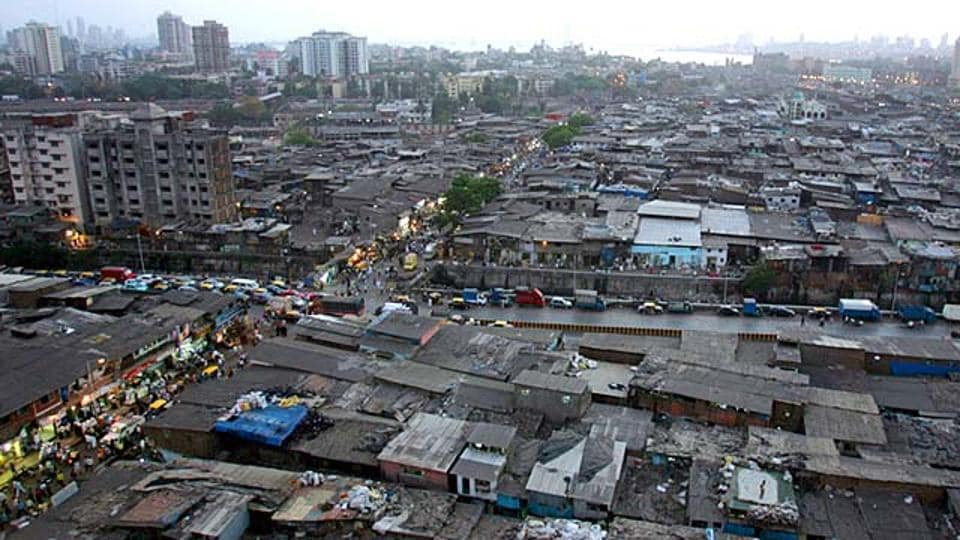 An aerial view of Dharavi slums in Mumbai. New migrants in a city prefer to rent. When migrants belong to low-income groups, they usually find a shelter in the city's slums thanks to kinship and other social networks