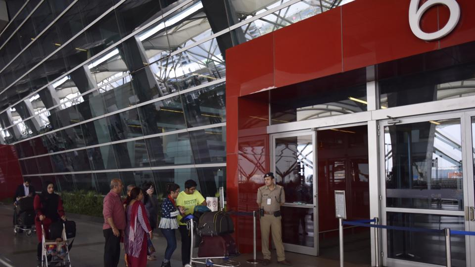 Six men and a customs official were arrested for smuggling goods at Delhi's IGIairport.