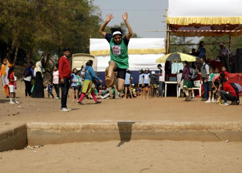 Jhanvi Chorghe of under-12 category in action at the long jump event at the Maharashtriya Mandal's Chandrashekar Agashe College of physical education ground on Friday. (RAHUL RAUT/HT PHOTO)