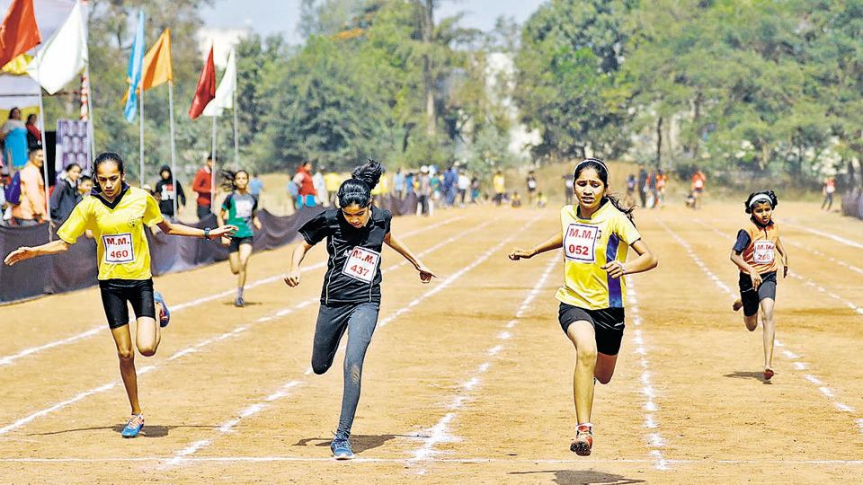 Participants of the under-12 girls' category in action during 100-metre run at the Maharashtriya Mandal's Chandrashekar Agashe College of physical education ground on Friday. (RAHUL RAUT/HT PHOTO)