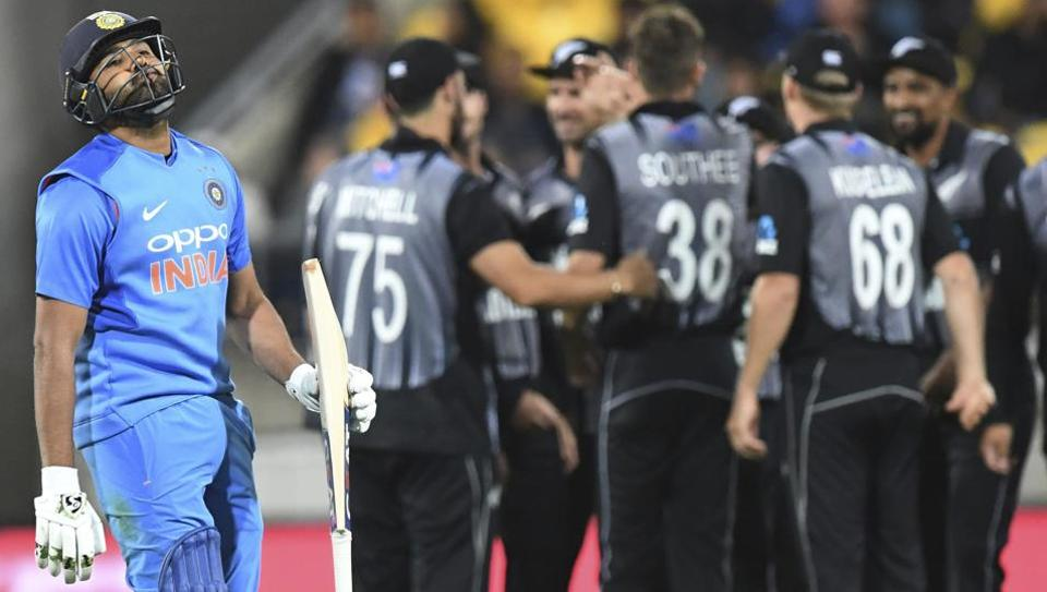 Rohit Sharma walks, out for 1, caught by New Zealand's Lockie Fergusson off the bowling of Tim Southee. (AP)