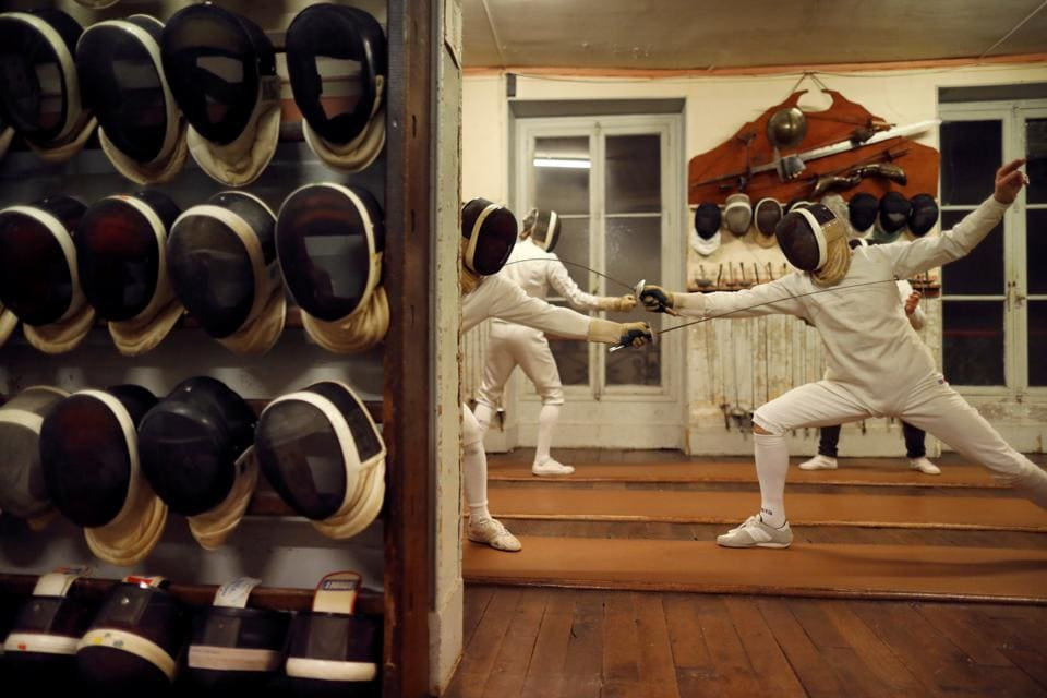 Members attend a training session at the Salle d'Armes Coudurier in central Paris, France. Things are still done the old fashioned way here, at the oldest fencing club in Paris, keeping the gentleman's traditions of the sport alive. (Charles Platiau / REUTERS)
