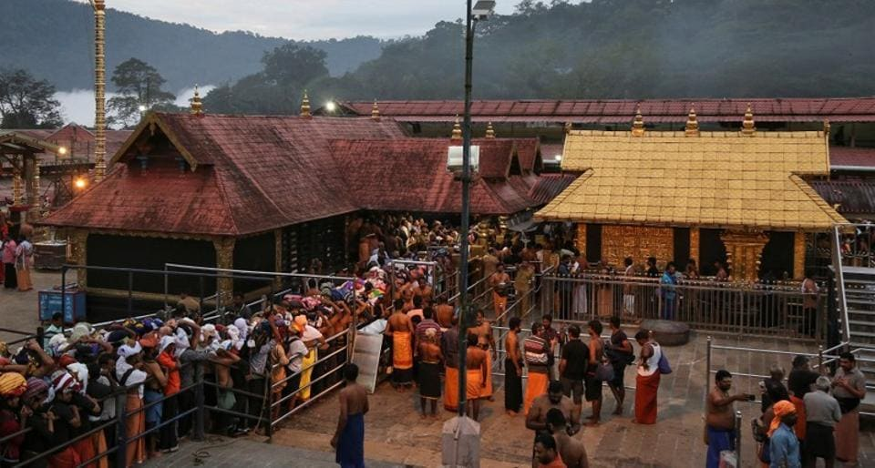 Devotees wait in queues inside the premises of the Sabarimala temple in Pathanamthitta district in Kerala on October 18.