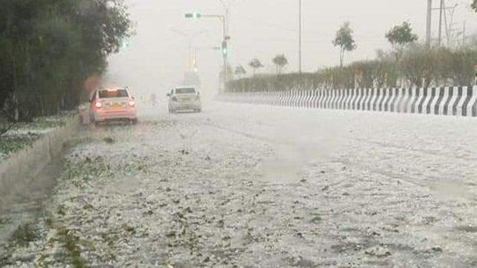 A road covered with hailstones at Noida, Sector 82 on February 7.