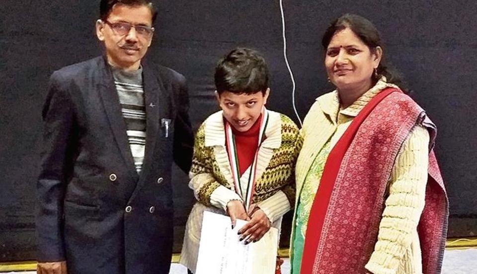 Riya Chowdhury with her parents on Wednesday