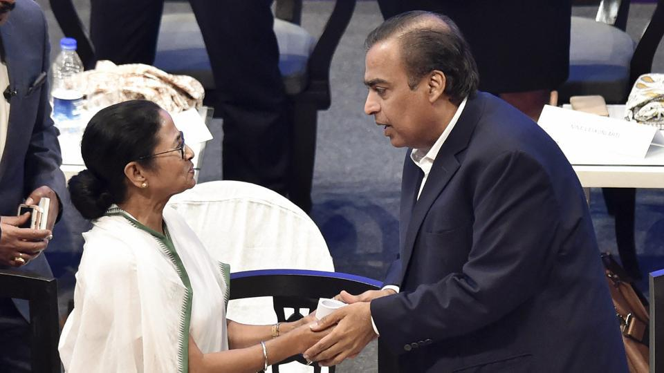 West Bengal chief minister Mamata Banerjee shakes hand with Reliance Industries chairman Mukesh Ambani during 'Bengal Global Business Summit 2019', in Kolkata on February 7.