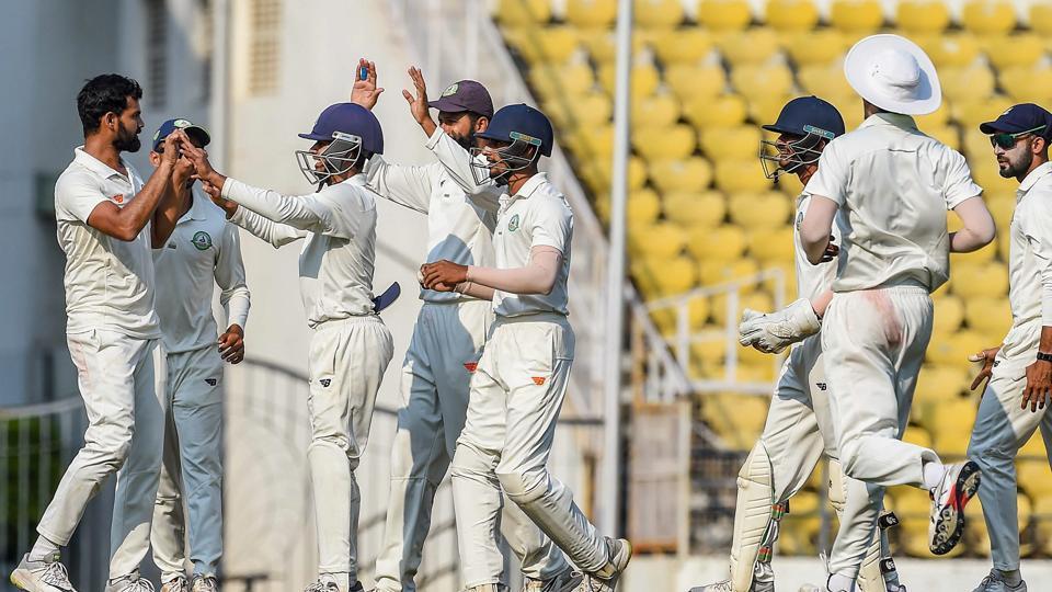 Vidarbha bowler Aditya Sarwate celebrates with teammates after dismissing Saurashtra batsman Cheteshwar Pujara.