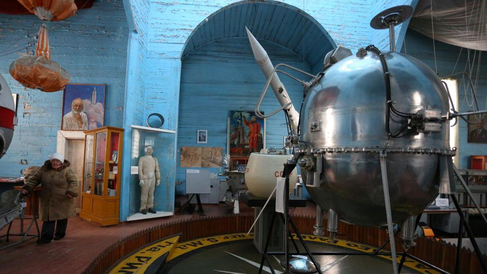 "Museum staff say clerics have even tried out the acoustics, but there are no plans of reconsecration. ""The museum was founded in the 1970s,"" said Sergiy Volkodav, its chief curator. ""It happened when space flights were wildly popular and every boy dreamed of becoming a cosmonaut,"" he said, standing beside a spacesuit worn by cosmonaut Vyacheslav Zudov for a spacewalk in 1976. (Aleksey Filippov / AFP)"