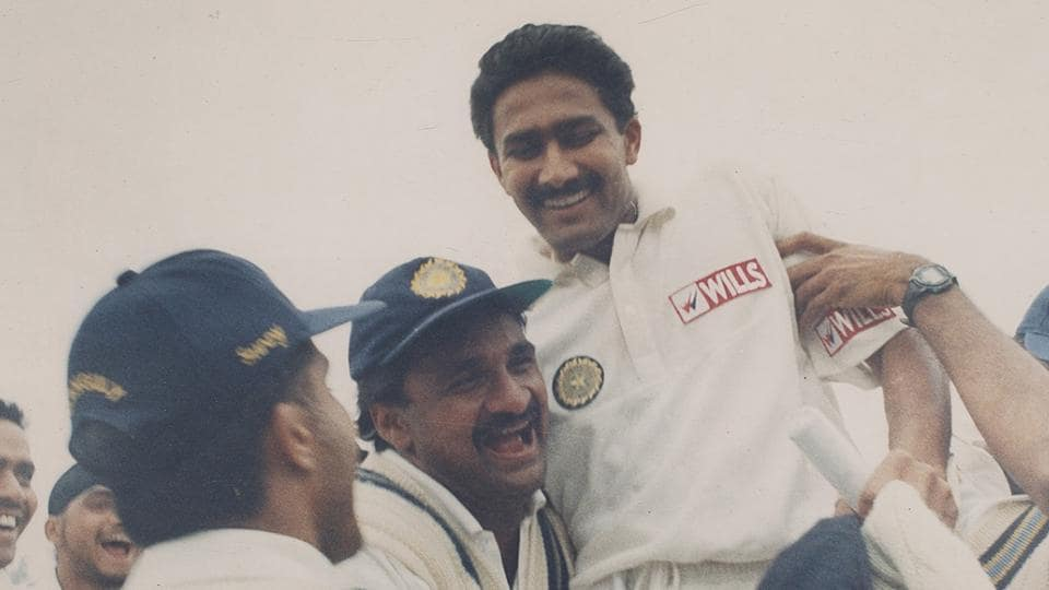 Anil Kumble celebrates with his teammates after picking up 10 wickets against Pakistan.