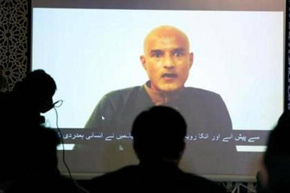Former Indian navy officer Kulbhushan Jadhav is seen on a screen during a news conference at the Ministry of Foreign Affairs in Islamabad, Pakistan December 25, 2017.