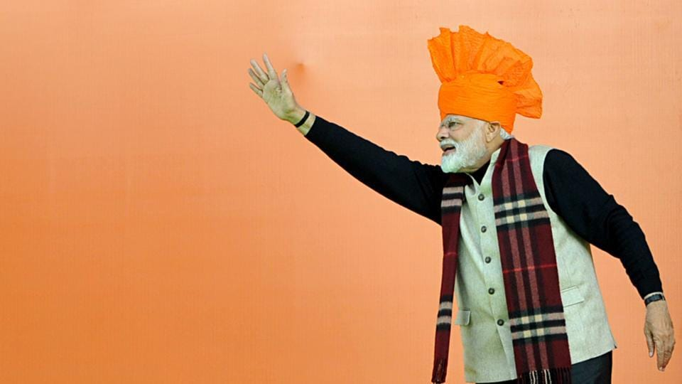 Prime Minister Narendra Modi waves to supporters during a public rally, in Jammu, Jammu and Kashmir. He laid the foundation stone of AIIMS and Jammu-Akhnoor four-lane Highway during his visit at Vijay Pur in Samba district of the state. (Nitin Kanotra / HT Photo)